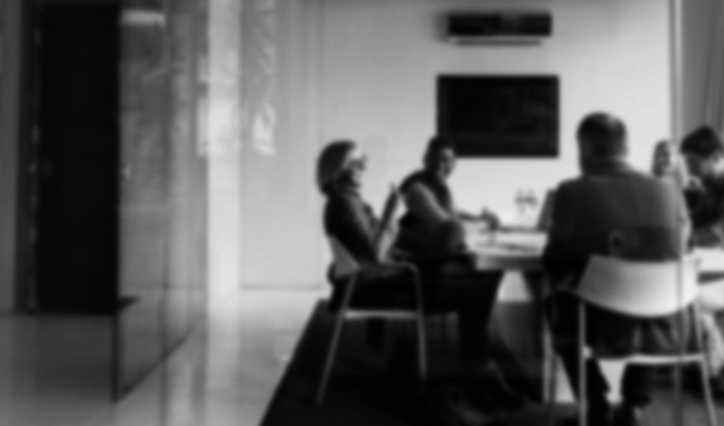 Blurred photo of office team meeting